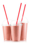 Red fruit smoothie in three size of pet cup Stock Photo