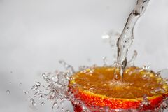 Red Fruit Spilled With Water Time Laps Photo Stock Image