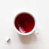 Red fruit tea cup with tea bag. Top view on white background with copy space. Healthy tea drinking Royalty Free Stock Photo