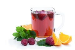 Red fruit tea with raspberry and orange isolated on white background stock photo