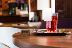 Red fruit tea in tearoom. Nobody.Reserve for friends Royalty Free Stock Photography