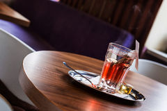 Red fruit tea in tearoom. Nobody.Waiting for friends Stock Image