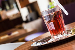 Red fruit tea in tearoom. Nobody.Waiting for friends Royalty Free Stock Photography