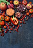 Red fruit, vegetable and bean. Apple, tomato, currant, radish, pepper, raspberries, cherry, lentils olive. Healthy food, vegetaria Royalty Free Stock Photography