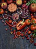 Red fruit, vegetable and bean. Apple, tomato, currant, radish, pepper, raspberries, cherry, lentils olive. Healthy food, vegetaria Stock Photos