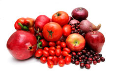 Red Fruit And Vegetables. Vegetables and fruit all of red coloring including pomegranate, red pears, large and cherry tomatoes, apples, sweet potato, chili Royalty Free Stock Photography