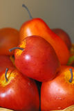 Red Fruits. Ornamental bright red apples and pears ready to be served Stock Photography
