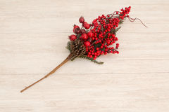 Red fruits on the branch Christmas for decoration. On a wooden background Stock Image