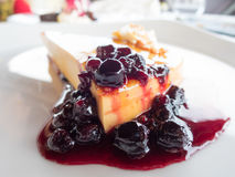Red fruits on cheese cake Stock Images