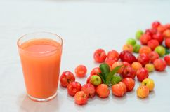 Red fruits and juice. Simple cup with tropical juice made with red fruits and acerola. very healthy and rich in vitamins Stock Photography