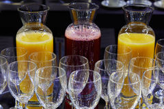 Red fruits and orange juice and crystal glasses stock photos