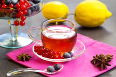 Red fruits tea with berries on cake stand Royalty Free Stock Image