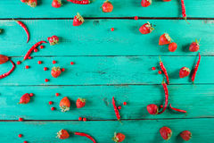 Red fruits and vegetables on a white on a wooden background. Colorful festive still life Royalty Free Stock Photo