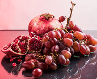 Red fruits and wine Stock Images