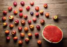Red fruits on a wooden table Stock Photo