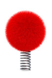 Red fur ball with spring Royalty Free Stock Photography