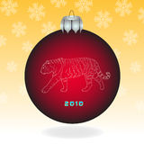 Red fur-tree ball. With a tiger on an orange background with snowflakes Royalty Free Stock Photo