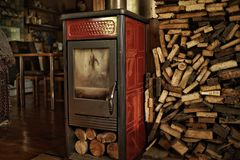 Red furnace indoors firewood room wood house. Village stock photos