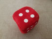 Red furry dice for children playing stock image