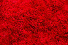Red furry fabric, texture, background Stock Photo