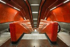 Red futurist staircase. Red underground escalator in a subway station Stock Photos