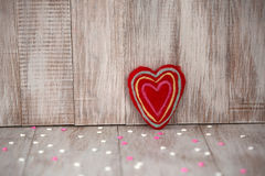 Red Fuzzy Handmade Heart on Vintage Wood Background Stock Photos