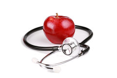 Red gala apple with stethoscope Stock Photo