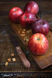 Red Gala apples on an old wooden surface Stock Images