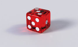 Red game die with refraction Royalty Free Stock Image