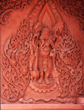 Red Ganesha statue on the wall in thai temple Royalty Free Stock Image