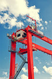 Red gantry crane detail against blue sky. Industrial crane in Santa Cruz de Tenerife port Royalty Free Stock Photography