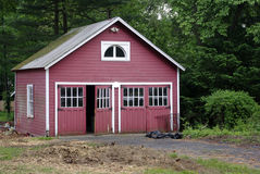 Red Garage. Old red garage by a driveway in a yard Stock Photography