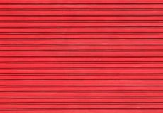 Red garage door. Abstract composition of a garage door with a brightly colored frame closed royalty free stock image