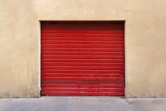 Red garage door. Closed red garage metal roller door exterior royalty free stock photos