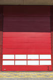 Red garage door. A red garage door at a Fire Station stock image