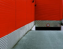 The red garage. Red road and garage entrance Stock Images