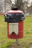 Red garbage bin Stock Images