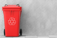 Red Garbage Trash Bin. 3d Rendering. Red Garbage Trash Bin in front of brick wall. 3d Rendering Stock Image