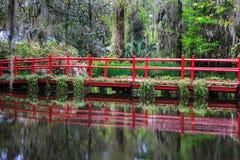 Red Garden Bridge Charleston South Carolina. Bright red ornamental pedestrian walking bridge over water in Charleston, South Carolina Stock Photos