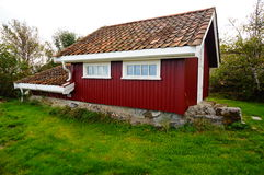 Red garden house near fjord Kragero, Portor Royalty Free Stock Photography