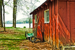 Red Garden Shed/Wheelbarrows Stock Image