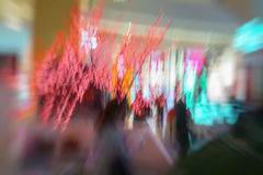 Red garland, christmas ornaments, in the shopping center, xmas, twinkle lights. Abstract defocused motion blurred. Red garland, christmas ornaments, in the royalty free stock image