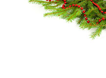 Red garland on a Christmas tree Royalty Free Stock Images