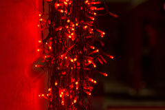 Red garland, lights for Christmas, New Year holiday. Outdoor Royalty Free Stock Image