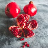 Red garnet fruit on dark background. Royalty Free Stock Images
