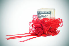 Red garter and money Royalty Free Stock Image