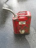 Red gas can on the pavement. A red gas can on the pavement stock photos