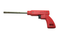 Red gas lighter in shape of gun Stock Photos