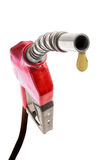 Red gas nozzle with one last drop. On white background Royalty Free Stock Photo