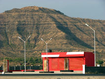 Red Gas Station. A new gas station (called petrol pump in India) still to commence its services on a mountainous landscape Stock Photo